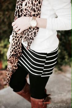 White long sleeve + leopard scarf + black an white skirt + black legging + casual boots