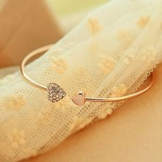 Shop Women's Gold Silver size OS Bracelets at a discounted price at Poshmark. Description: Brand new, rose gold rhinestone heart cuff bracelet.