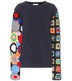 JW Anderson - Cotton and wool-blend sweater - JW Anderson's sweatshirt is a quirky style that will liven-up your fall edit in an instant. A cotton jersey bodice if finished with crochet-knitted sleeves featuring a different pattern on either side. Wear yours with a bold-hued skirt to highlight the multicoloured floral design. seen @ www.mytheresa.com