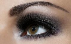 Close up of young woman's eye with make up - Andreas Kuehn/Stone/Getty Images