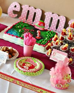 Cute dessert table! Get ideas from this Strawberry Shortcake party styled by Cat at Food Family & Finds for her daughter Emma.
