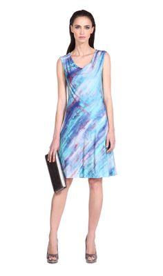 Hermoso vestido de manga rebasada, ideal para tus eventos de día.