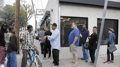 Patrons line up outside Locol Healthy Fast food restaurant in Watts CA