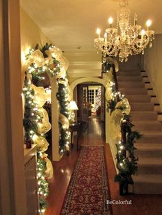 Beautiful christmas decorations - I might try ribbon wrapped around lighted garland this year.