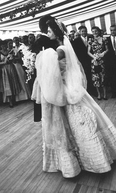 John F. Kennedy and Jacqueline Kennedy embrace during their first dance at their wedding in New Port, Rhode Island