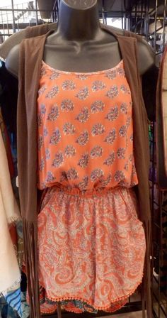 Orange paisley Romper with pockets and a brown fringe vest