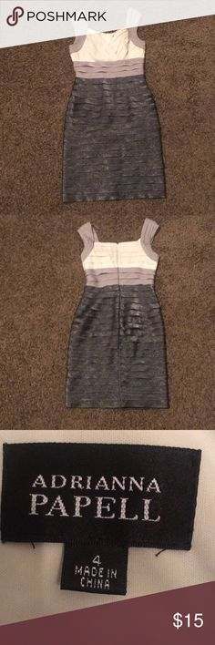 Sliver and white dress Silver and white dress. I'm good condition. Size 4 Adrianna Papell Dresses Midi