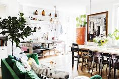 Industrial / vintage style in the colourful kitchen of the happy Swedish home of Elsa Billgren. Photography: Beata Holmgren.