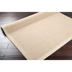 This would be a rug you would layer under the animal rug or vintage rug. It is a jute material but it is a flat weave.