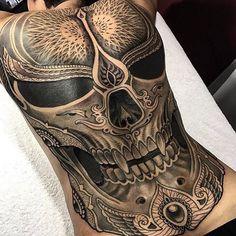 Skull backpiece tattoo
