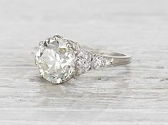 Vintage Edwardian engagement ring made in platinum and centered with a 3.93 carat GIA certified old European cut diamond with M color and VS1 clarity. Circa 1910. This ring is a stunner! The center diamondis set in eight delicate prongs. Set atop athin and incredibly feminine band making for a showstopping engagement