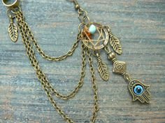 ONE hamsa hand evil eye dreamcatcher chained ear by gildedingypsy, $19.00