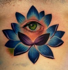 A perfectly blue lotus flower tattoo with an eye in the middle. This can mean a lot of things but the simplest way to put it is that the person wants to show that he or she has opened his or her eyes to new thinking and possibilities that the present and the future might hold.