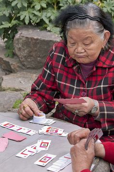 Playing Mah-jong with cards. People's Square, Shanghai (2010)
