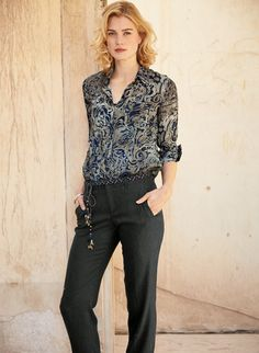Hand-painted paisleys swirl across our drapy, semi-sheer viscose shirt in tonal hues of Rust/Brick or Navy/Pewter. Elegantly finished with a hidden button placket, pockets and shirttail hem.
