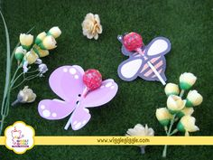 For dessert table, you can decorate the lollipop stick with decoration that looks like garden, so they will look like butterflies flying over a green garden. You can also add flowers decorations and bee lollipops.   For a simple souvenirs,  wrap the butterfly or bee lollipops in a transparent plastics, tie them up with twine string and just add a thank you tags.  Visit us at www.wigglegiggle.com