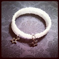 Memory wire bracelet made of 6mm pearly white seed beads with silver star charms