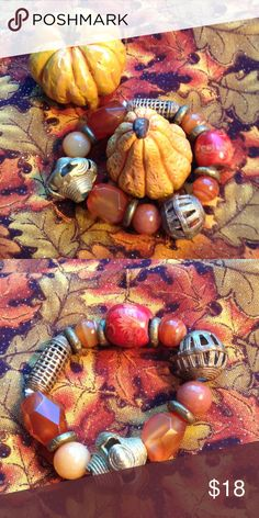 Carnelian and African brass bracelet. The leaves will soon be falling and it will be time to get out your fall clothes.  At least in the northern part of the US! This bracelet is almost all lovely carnelian, a wood painted bead, and handmade African brass. It's not damaged, just authentic! Jewelry Bracelets