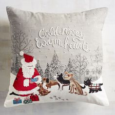 """You may tell your pups that they're a """"good boy"""" or """"good girl,"""" but Santa knows if they've really been naughty or nice. Whatever his ruling, go ahead and celebrate man's best friend with our soft pillow and its sweet sentiment. Crafted with a supportive poly insert and no-show zipper."""