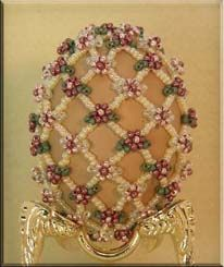 Maybe next year I'll make eggs instead of ornaments.  Because this designer has some gorgeous patterns for sale.