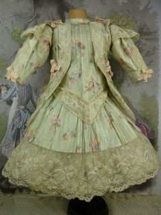 EXCEPTIONAL FRENCH OLIVE FLOWERED SILK COUTURIER DRESS WITH MATCHING BONNET SUITED FOR AN EXCEPTIONAL BÉBE from Jeannie Hazendonk/Stairway To The Past at Ruby Lane