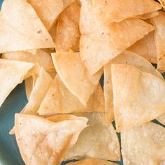 Make your own crispy corn tortilla chips at home with this recipe. All you need is a bit of oil, corn tortillas, and salt.