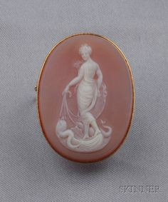 Antique Carnelian Cameo Brooch, depicting Aphrodite rising from the sea in a shell drawn by dolphins, gold mount.