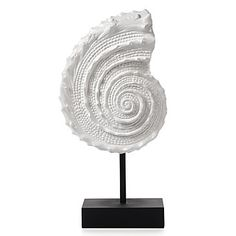 $99.95 Hit the refresh button for your decor by adding fresh bright White decorative accessories to your home. Our Spiral Shell on a Stand is a sunny reminder of warm days at the beach, molded in the likeness of a spiral shell and finished in upbeat glossy White lacquer. The Shell is mounted on a sleek and stylish contrasting Black stand.