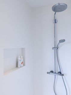 White Solid Surface shower by Dzignstone. Base line wall panels with wall niche for extra comfort in your shower.