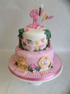 A Jungle Animals theme 1st birthday cake with girly colour theme