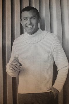 The man who wears this sweater knows who he is and where he's going! What a great vintage cabled design.  1960's Mad Men Hipster style - Vintage Knitting Pattern