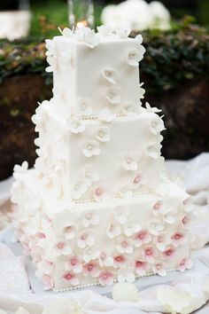 Cherry blossoms add lovely texture and color to this elegant wedding cake