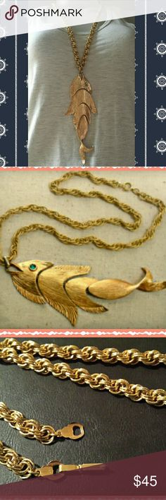 """Unique NAPIER Green Eyed Golden Fish Necklace Dated 1960s/1970s This very large golden fish pendant hangs from a golden rope chain is made and signed by NAPIER.  After World War 2, NAPIER was none for its bold gold jewelry set off by clear and colored rhinestones. Articulated Goldtone fish pendant measures 6 inches by 2"""" and 1/4"""" Rope chain measures 24"""" long Excellent  condition Napier Jewelry Necklaces"""