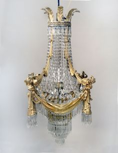 Charles Cheriff Galleries offers a stunning late century gilt bronze and drop crystal 15 light chandelier for sale. This item has a quality gilt bronze frame designed w/ curtains and bows. Baccarat Chandelier, Chandelier Table Lamp, Antique Brass Chandelier, Chandelier Fan, Chandelier For Sale, Lamps For Sale, Antique Lamps, Antique Lighting, Bubble Chandelier