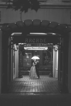 An illuminated kiss under the arcade in the France Pavilion in Epcot. Photo: Jacob, Disney Fine Art Photography