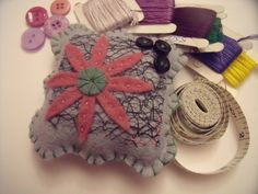Flower pincushion with lace detail