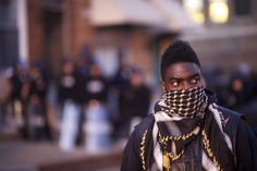 A motorcycle group formed a line in front of the Baltimore riot police the night…