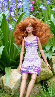 My latest crochet dress modelled by Antoinette in the garden with the bluebells.