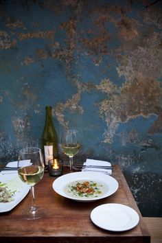...ok so this is the perfect cozy dinner setting. Love the aged plaster wall. Nicole Franzen Photography.