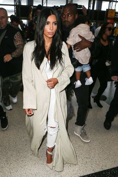 Who: Kim Kardashian What: A Billowing Coat Why: The airplane-bound reality star kept it light and casual in denim and a languid coat. Get the look now: Stella McCartney coat, $3,260, net-a-porter.com.