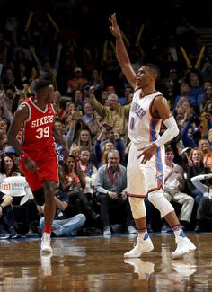 Oklahoma City's Russell Westbrook (0) celebrates a 3-point basket during the NBA…