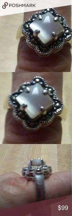 Mother of Pearl and Marcasites Ring This is a vintage mother of pearl ring with marcasites surrounding the diamond shaped mother of pearl bundle up with other mother of pearl items in my closet three or more items get you 15% off Jewelry Rings