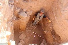 Steven Collins from Trinity Southwestern University in New Mexico, who has led the project , standing inside one of the large walls found at the site.