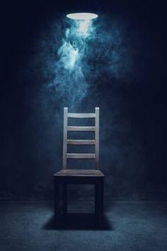Chair in empty interrogation room