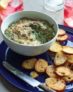 This dip combines frozen spinach, bacon, and onion with cream cheese, milk, sour cream, and a bubbly Parmesan topping for extra richness. Serve this crowd-pleaser warm with freshly made crostini or pita chips.