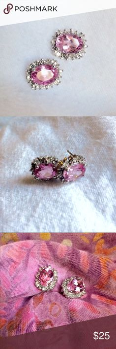 Pretty Pink Sapphire earrings with diamond accents Bling! Beautiful pink sapphire earrings, accented with white diamonds! Center stones are over 1 carat each probably closer to a carat and a half. Lovely clear and sparkly! Jewelry Earrings