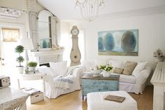 Swedish Living Room in White with Blue Accents - almost a hidden mirror but look at the room it has to reflect!
