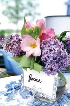 For a touch of elegance, place blooms in small bud vases at each place setting, and attach a name card.