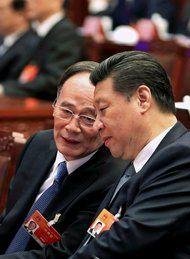 本月,中国国家主席习近平(右)和中央纪律检查委员会书记王岐山在全国人民代表大会上。
