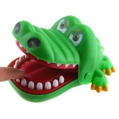 Crocodile Dentist was one of those terrifying but fun games from the 90s.. There are a few other scary, fun games I will pin. Can you guess which ones?